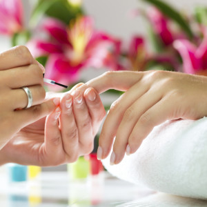 Woman in a nail salon receiving a manicure