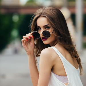 beautiful girl in sunglasses sitting