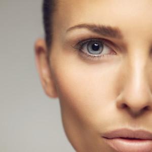 Young woman half face closeup