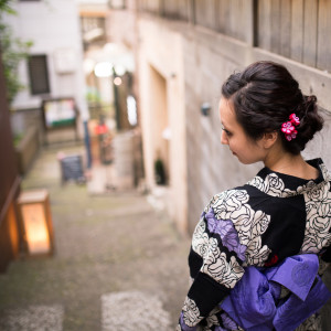 Young Yukata woman walking down narrow slope