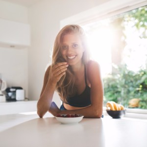 young-woman-eating-healthy-breakfast-picture-id629960504