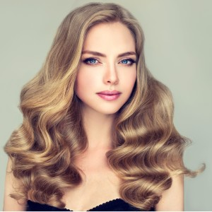 model-with-blue-eyes-and-wavy-hairstyle-picture-id615273228-1