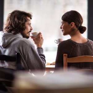 rear-view-of-smiling-couple-in-love-enjoying-in-cafe-picture-id540230320