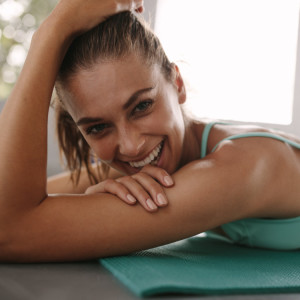 Close,Up,Of,Fit,Young,Female,Lying,On,Exercise,Mat